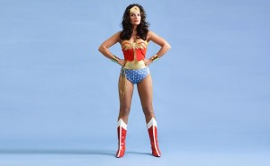 The iconic Wonder Woman pose, with feet apart, arms wide and hands planted on hips, is a good pose for this.